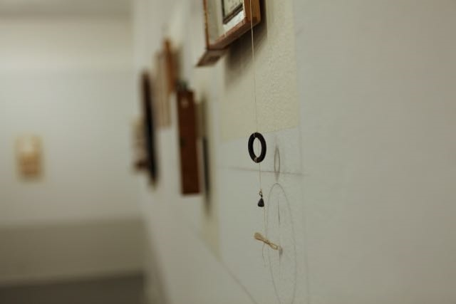 installation view of poem image/poem object at Woodland Pattern Book Center