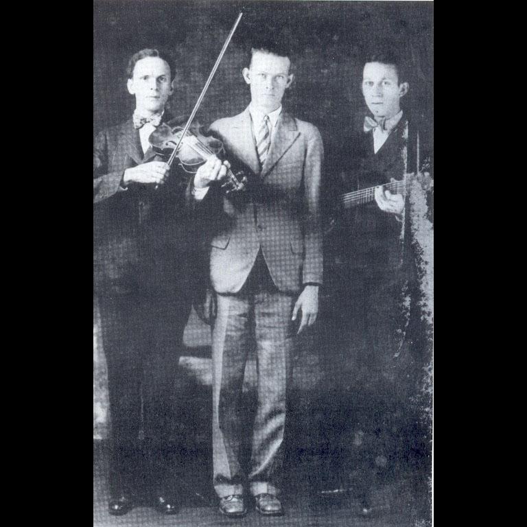 Dance caller, Ernest Legg (center) with the Kessinger Brothers (Charleston, WV, 1928)