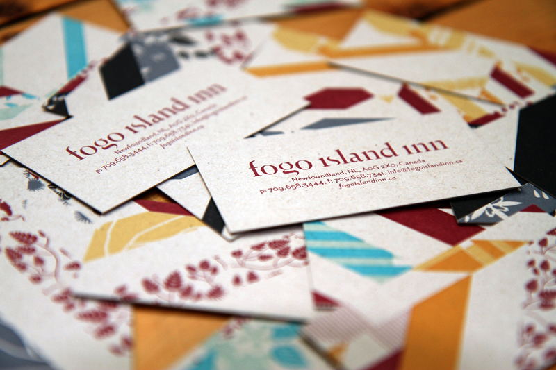 Business cards with Inn identity on custom pattern