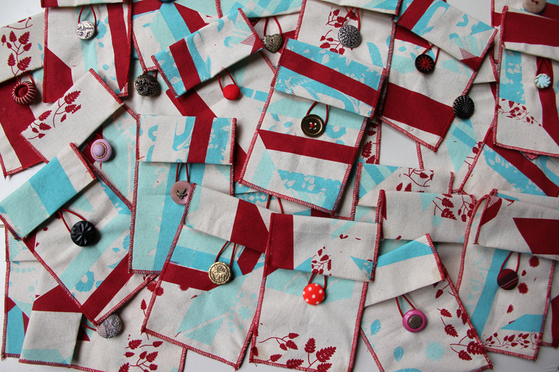 Custom playing card pouches with assorted buttons