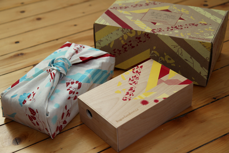 Packaging for word of mouth marketing campaign: wooden box with a peekaboo hole with aminiature diorama of a room at the Inn