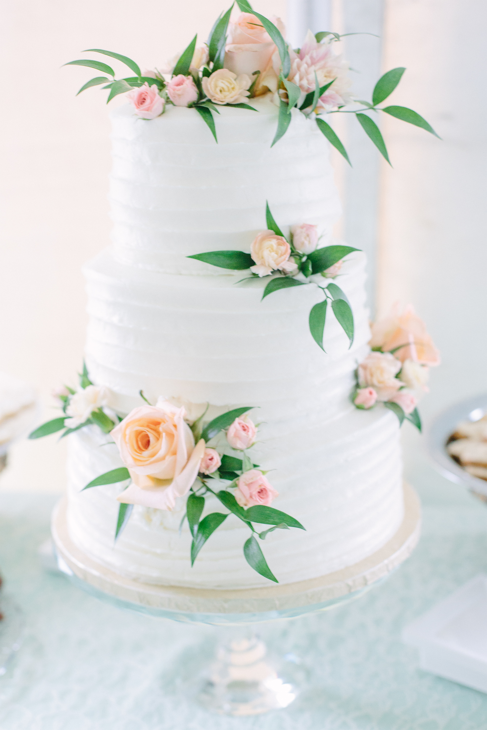 Bright and airy white floral wedding cake photo