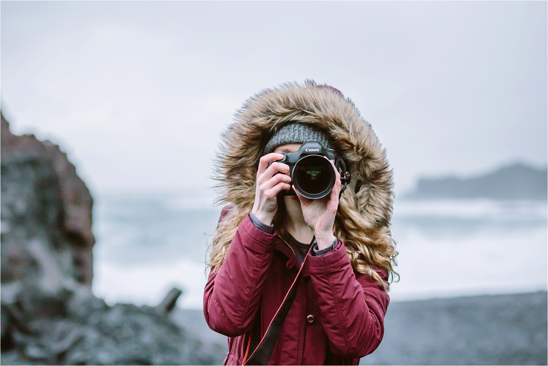 Me photographing on a black sand beach in the Snæfellsnes Peninsula (Djúpalónssandur)