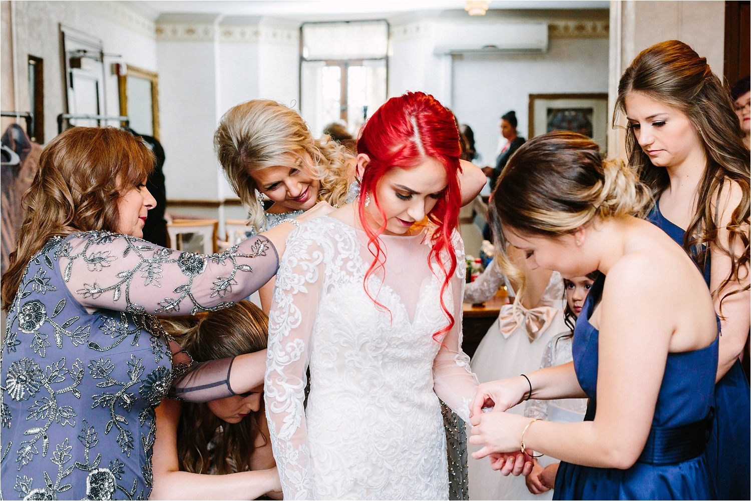 Some of my favorite photos from every wedding. Mamas and bridesmaids helping the bride with the dress.