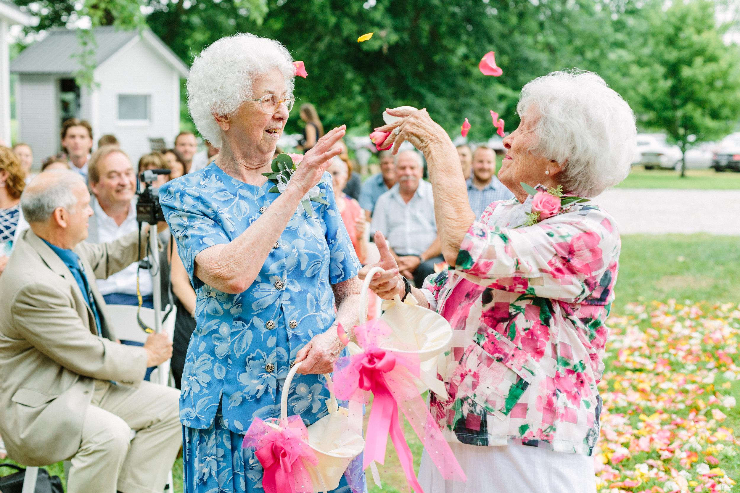 bright and airy wedding ceremony grandma flower girls photo