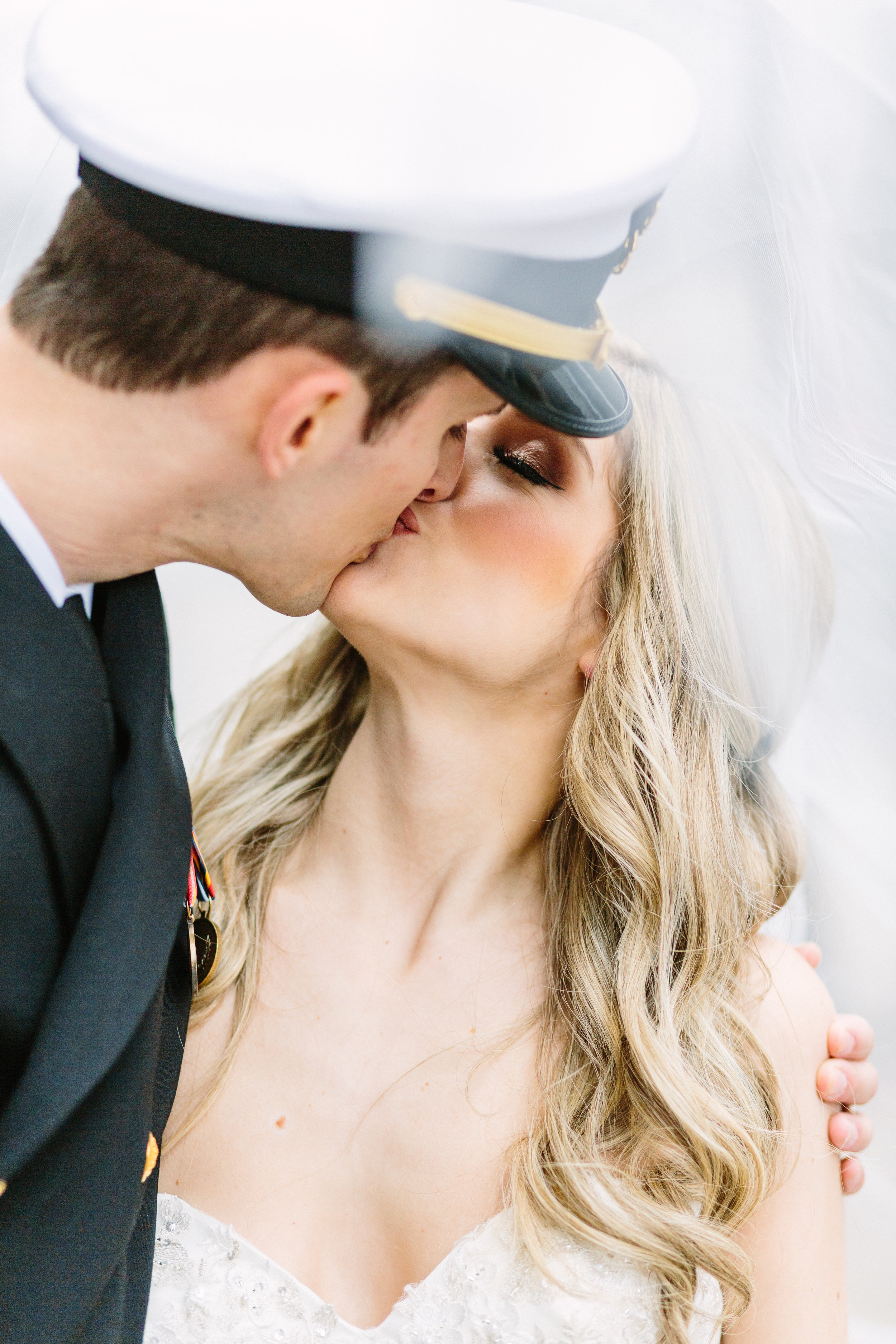 Romantic Youngstown bride and military groom kissing at Mahoning County Courthouse