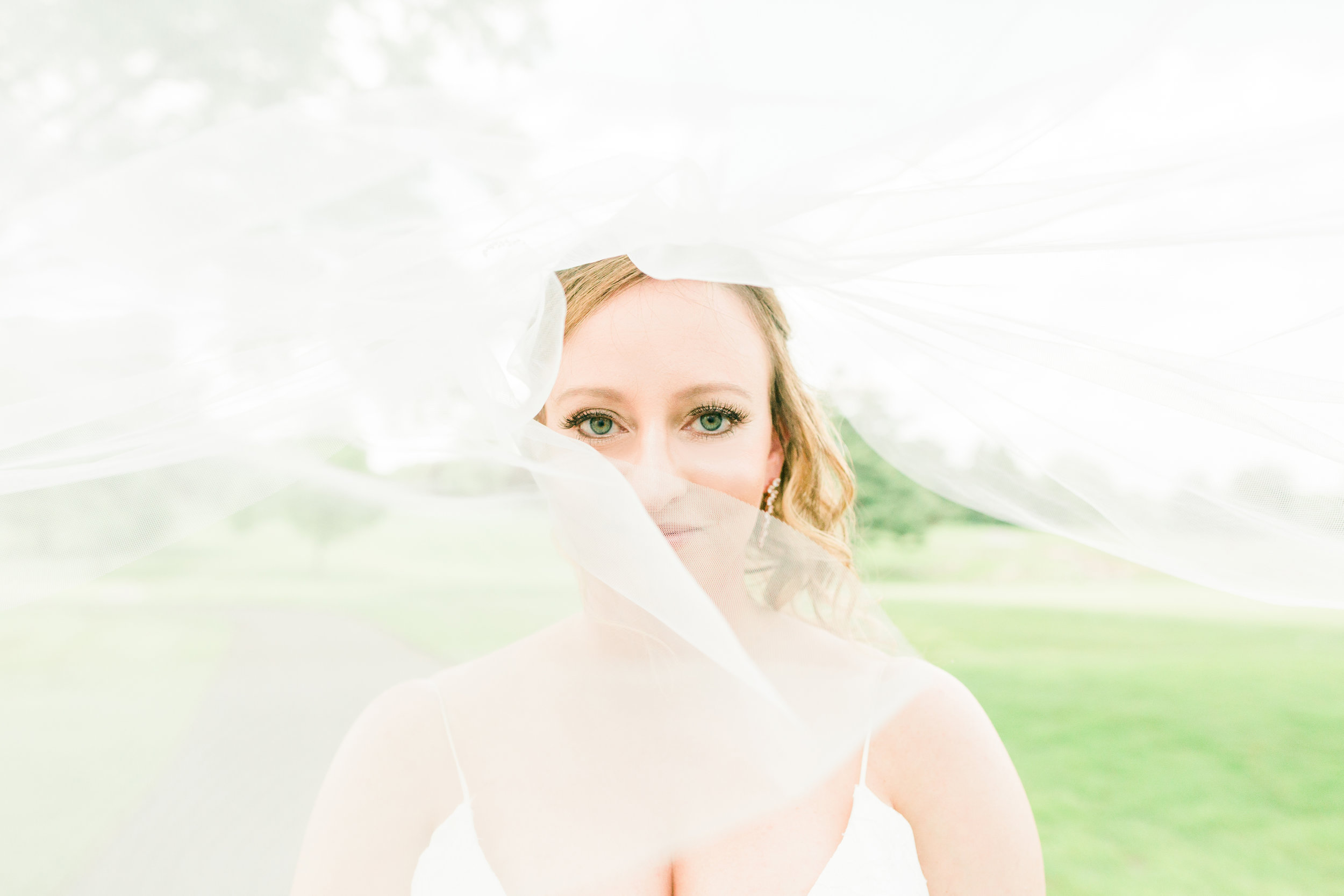 Gorgeous bride with long flowing veil