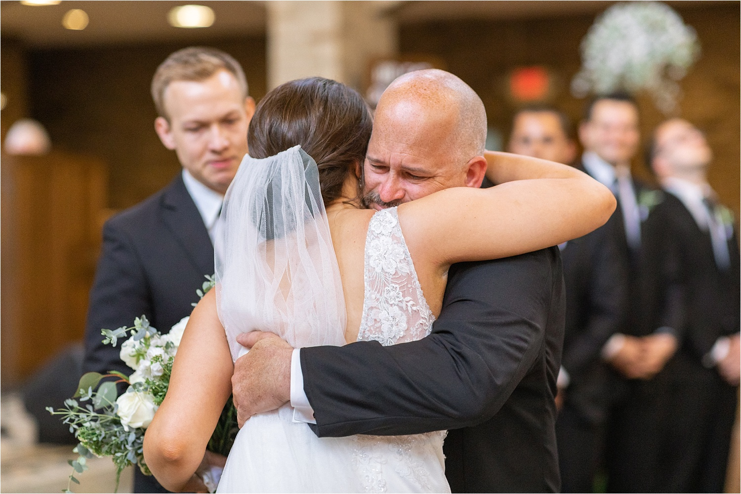 youngstown bride and her father hug before she says i do