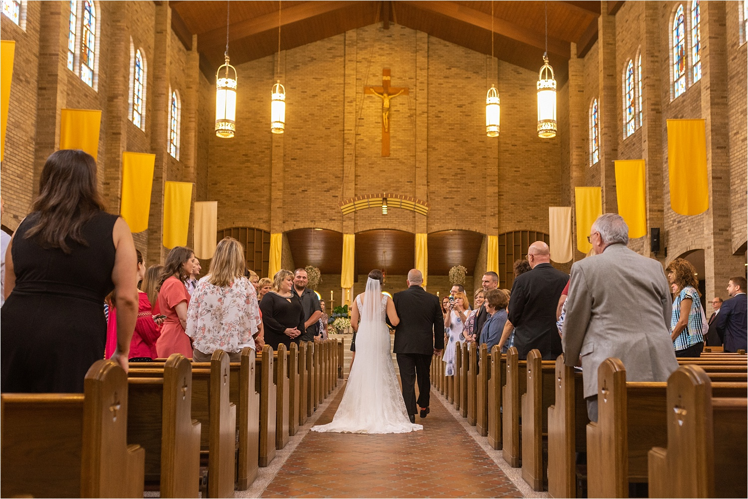 father and youngstown bride walk down the aisle