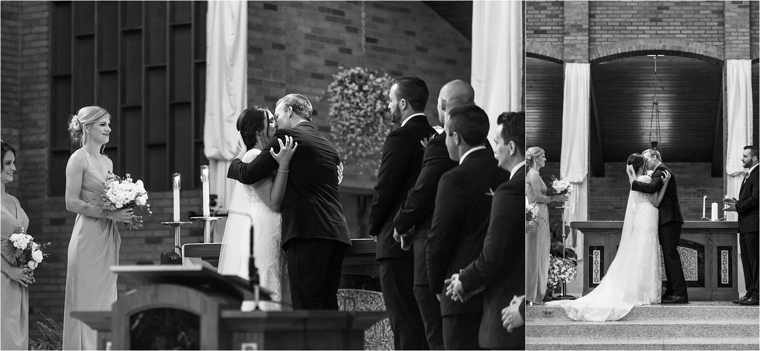 bride and groom kiss and say i do at their youngstown ohio wedding