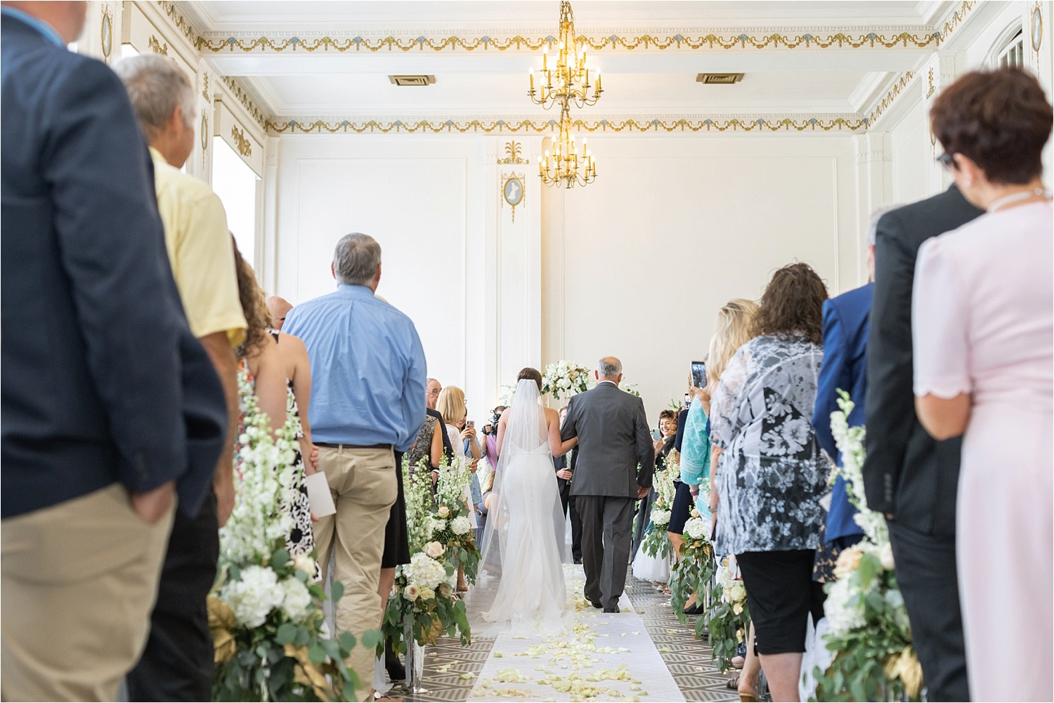 father and bride walk down aisle at wedding at the george washington hotel in washington pa