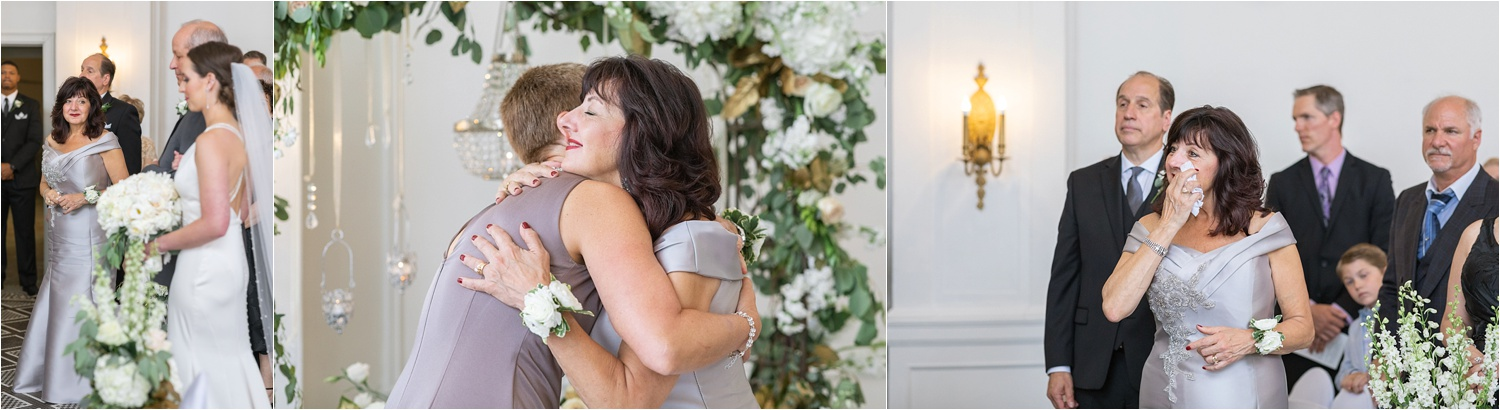 mothers of bride and groom share an emotional hug before the bride walks down the aisle at her wedding at the george washington hotel in washington pa