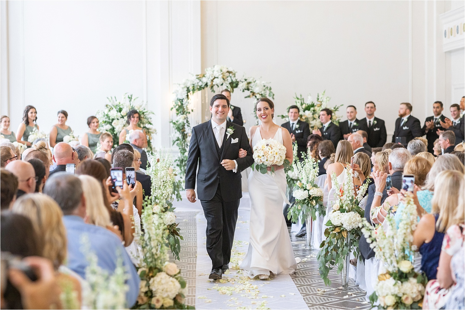 bride and groom walk down aisle after being married at the george washington hotel in washington pa
