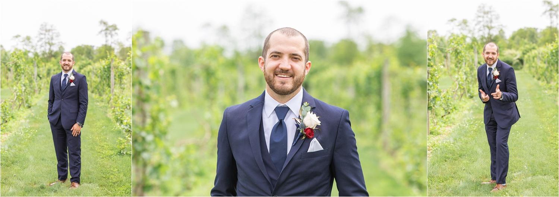 summer wedding photos of groom at the vineyards at pine lake
