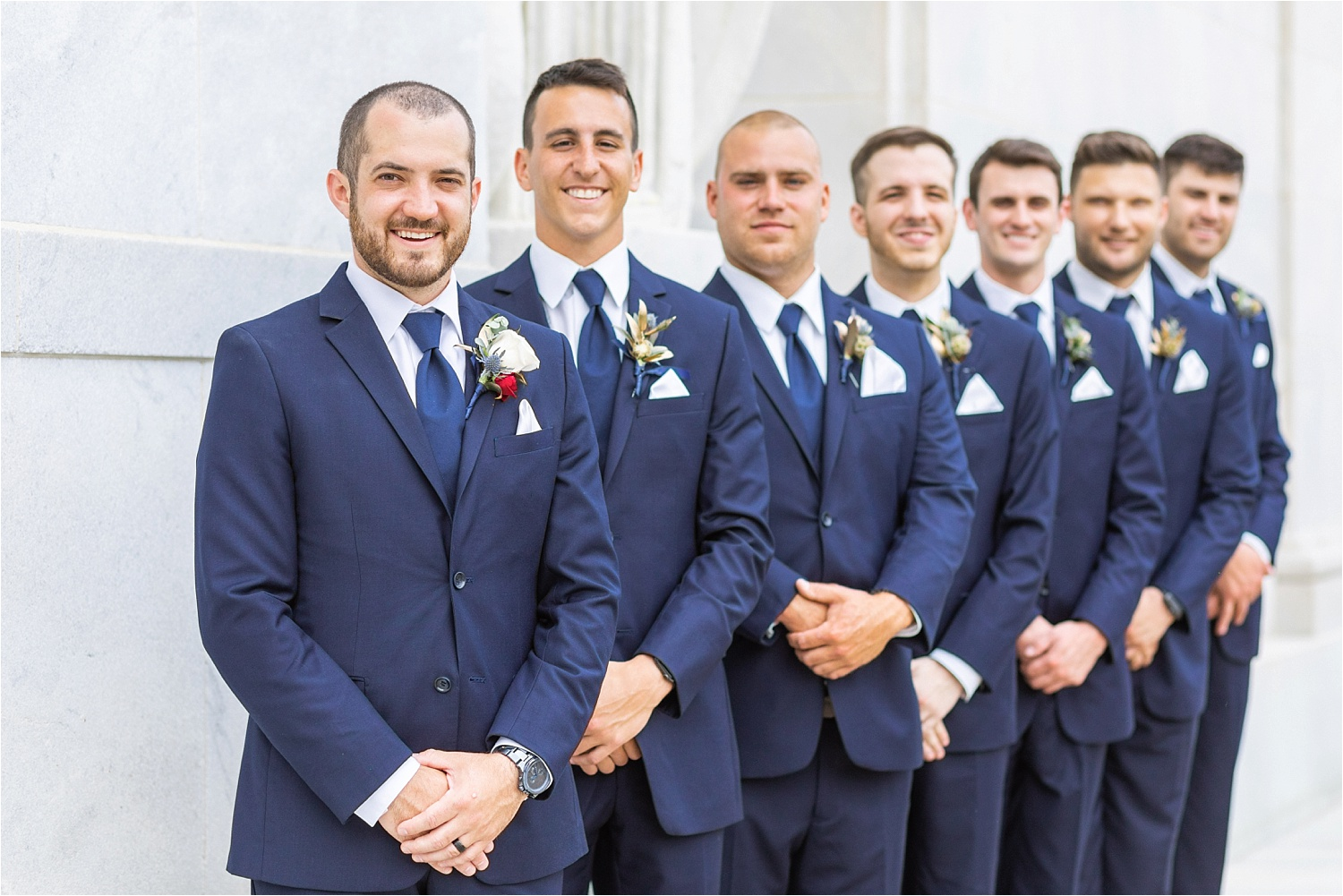 wedding photos of groomsmen at the butler institute of american art in youngstown ohio