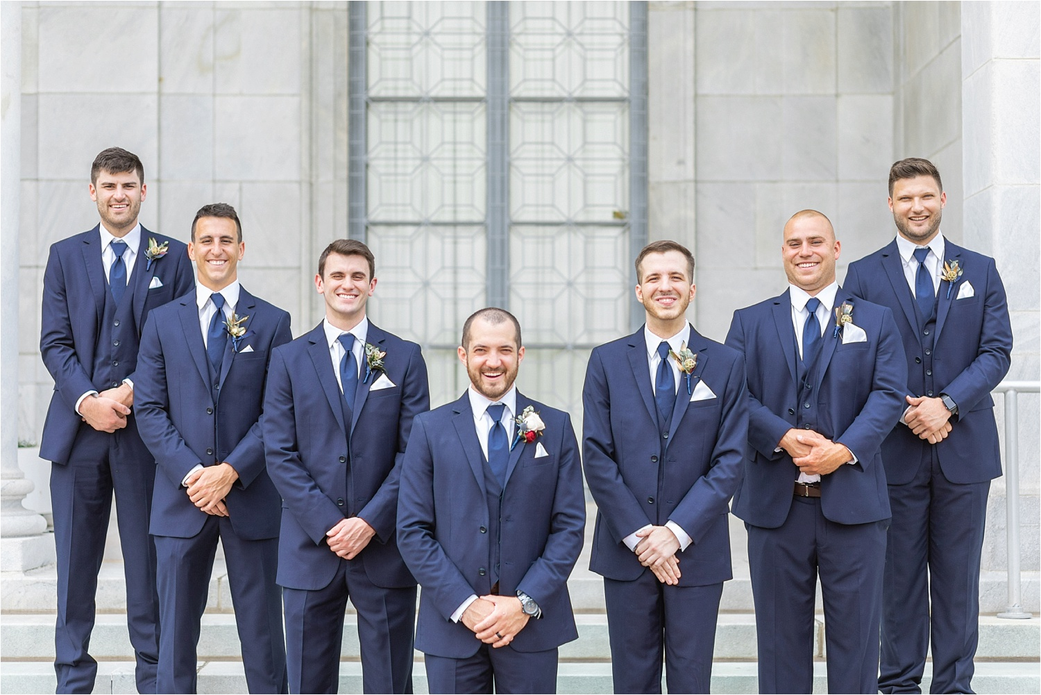 Guys looking classy in these navy suits from Rondonelli Tuxedo Company. Navy is always a great option & looks especially good with brown accents!