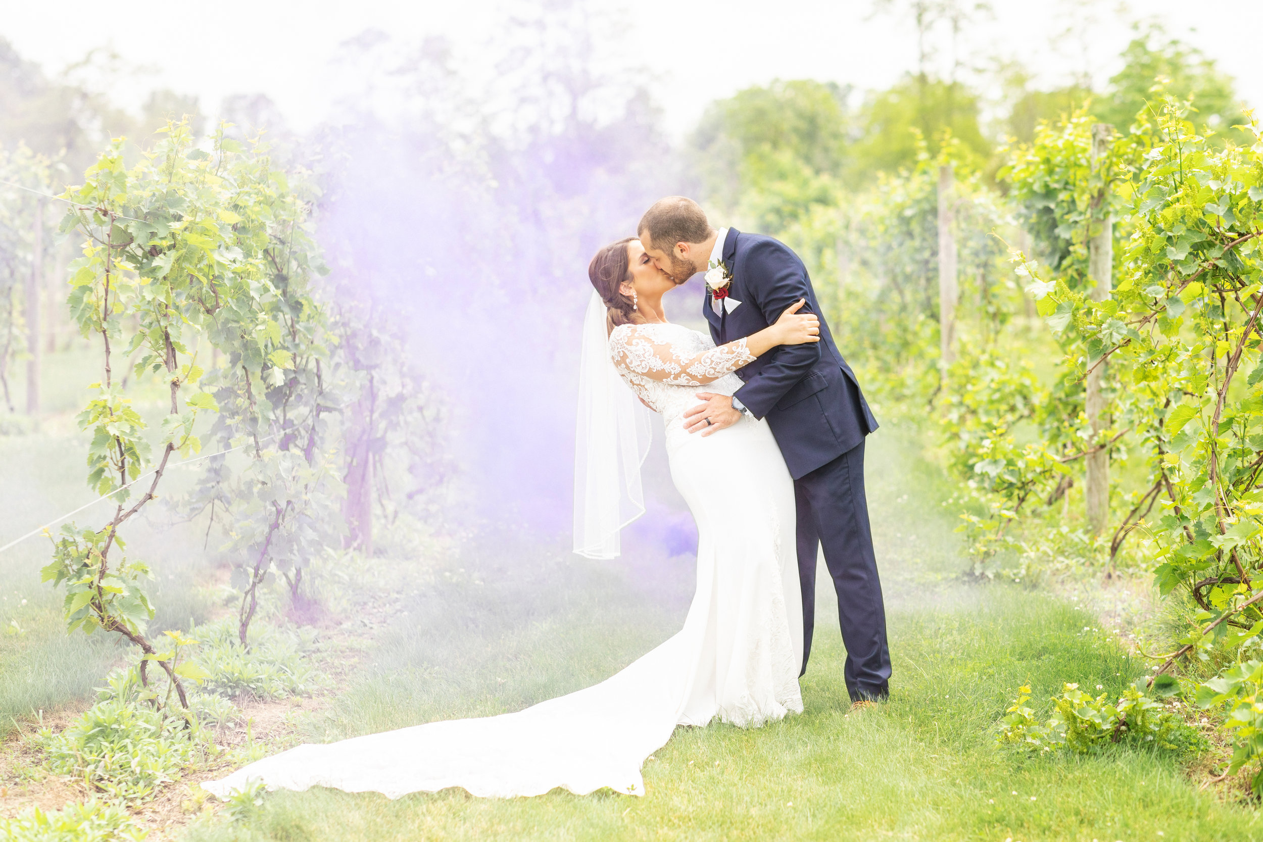 smoke bomb wedding photos at the vineyards at pine lake