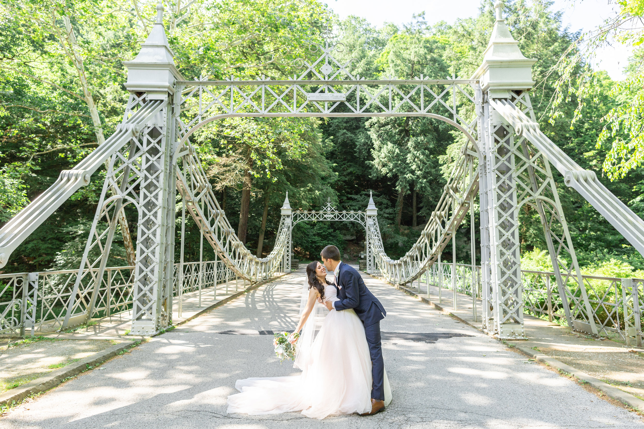 wedding portrait of bride and groom at the suspension bridge in mill creek