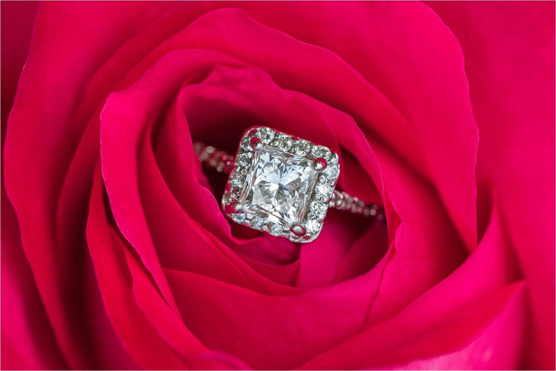 stunning engagement ring resting in red rose flower at fellows riverside gardens