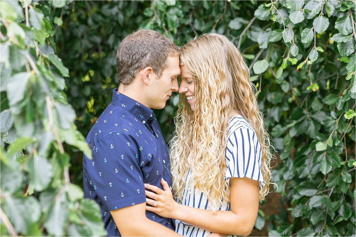 pretty fine art light and airy engagement photos at fellows riverside gardens in july 2019