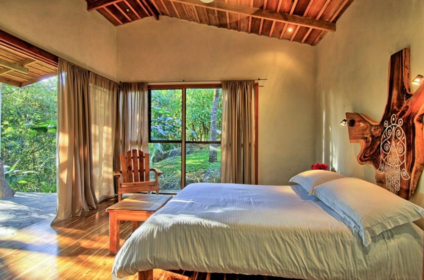 The bed in a suite at Hotel Mystica Costa Rica