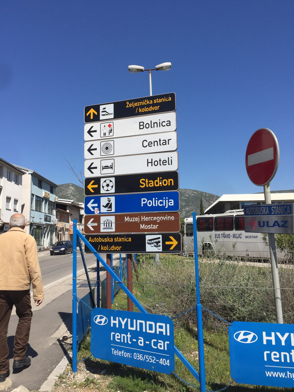 "As you walk to the bus station you will see these signs. Notice the very bottom ""Autobuska Stanica"""