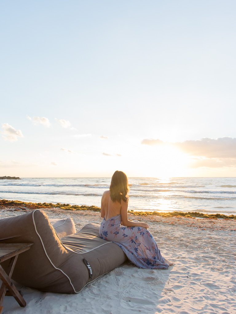 Watching sunrise on the bean bag chairs at Tata Tulum.