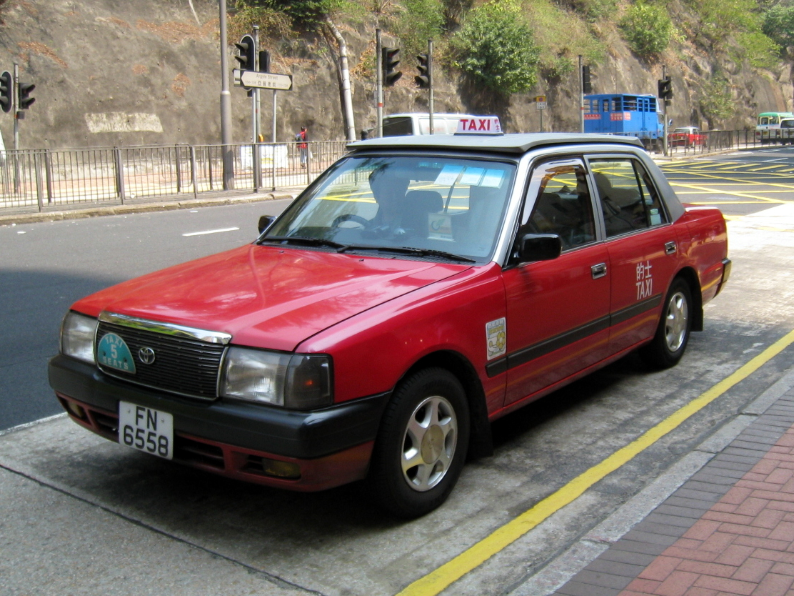 Taxis in Hong Kong come in different colors: Red, Green and Blue.