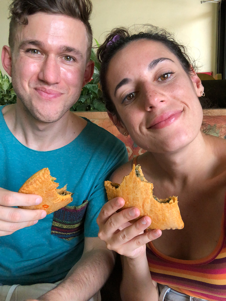 Enjoying Jamaican Patties at Juici Patties