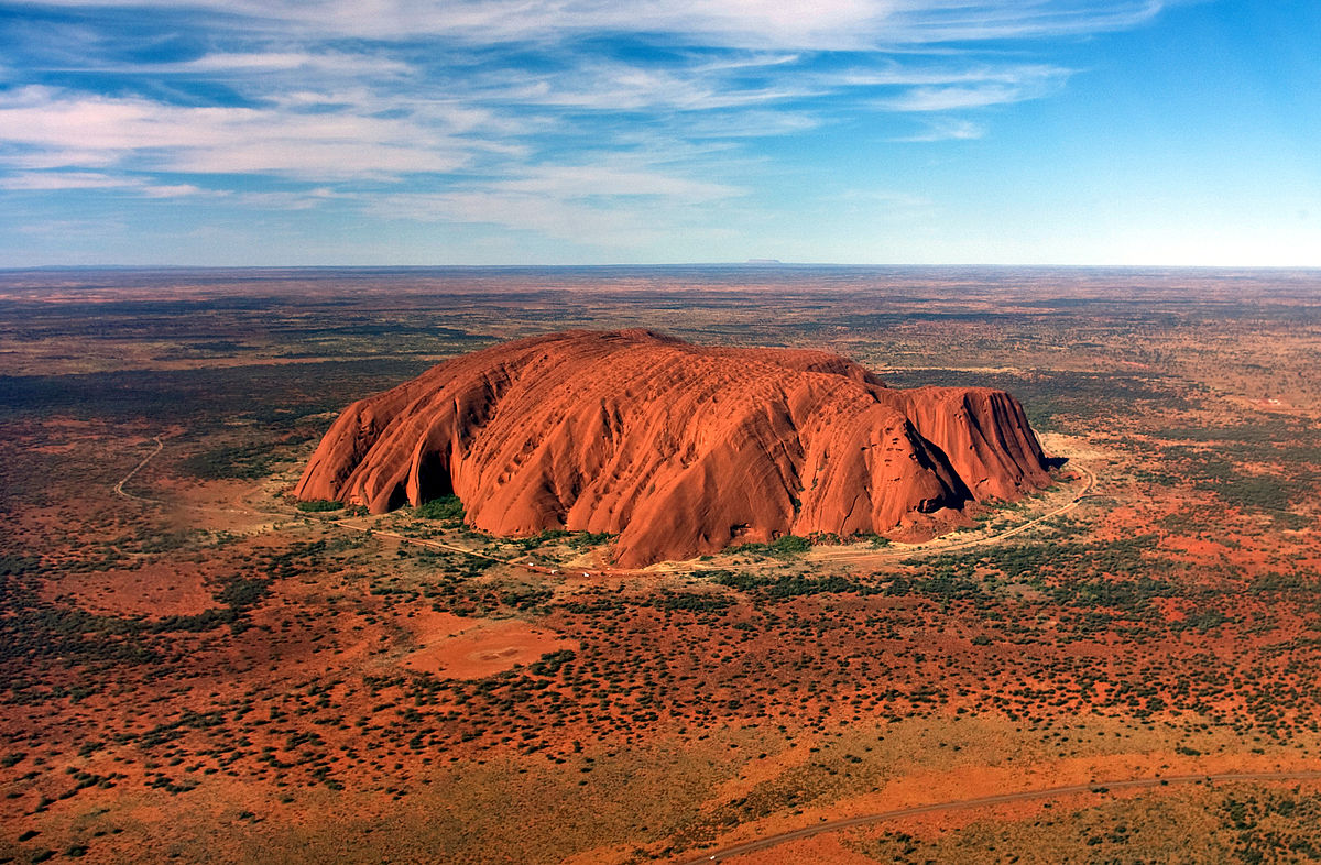 Uluru, one of the most beautiful sights in all of Australia. If you can visit it on a trip to Australia you should.  Source:  Wikipedia Commons