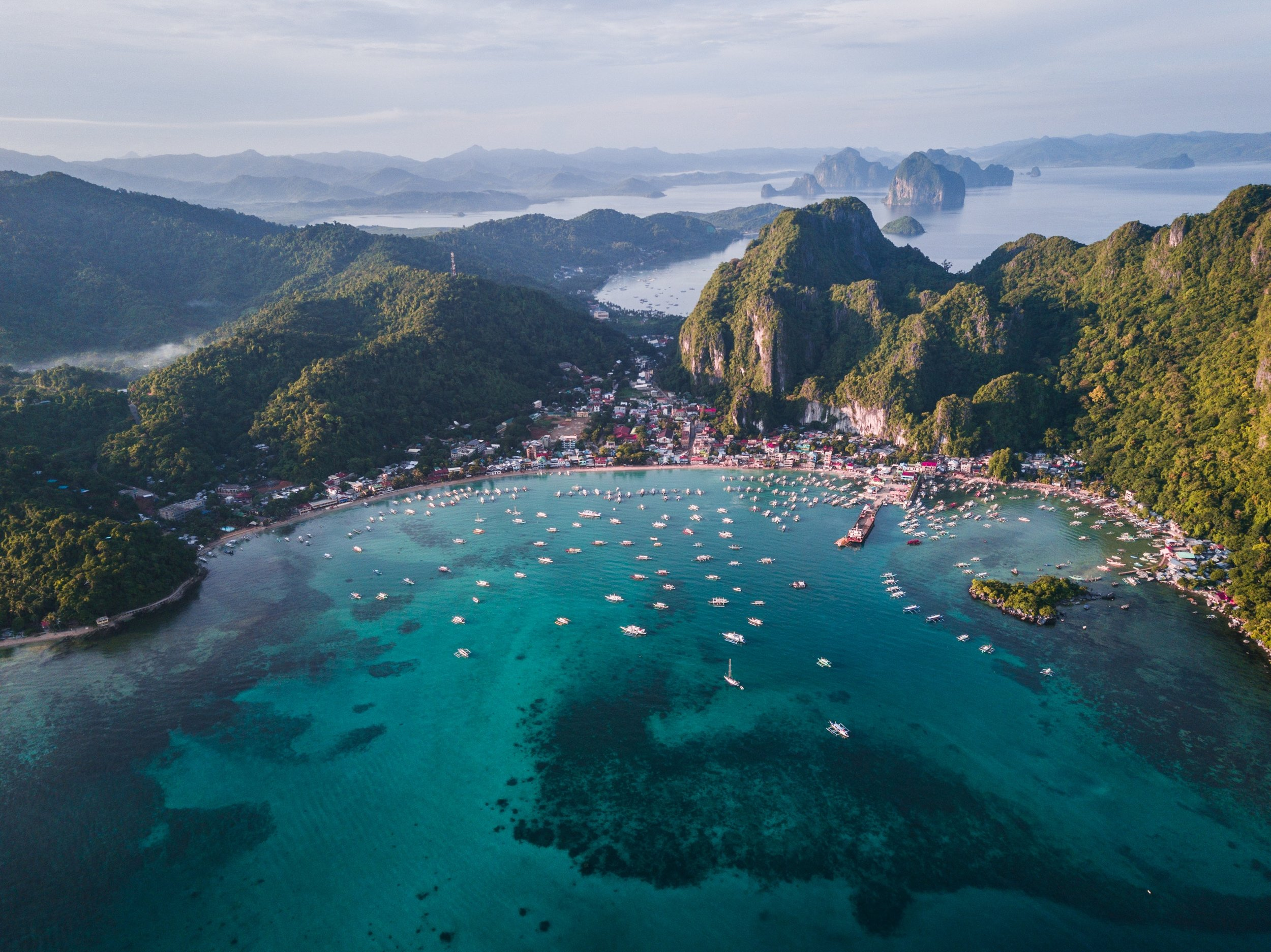 El Nido, a Philippine municipality on Palawan island is known for white-sand beaches and coral reefs.  Source:   Eibner Saliba     on   Unsplash