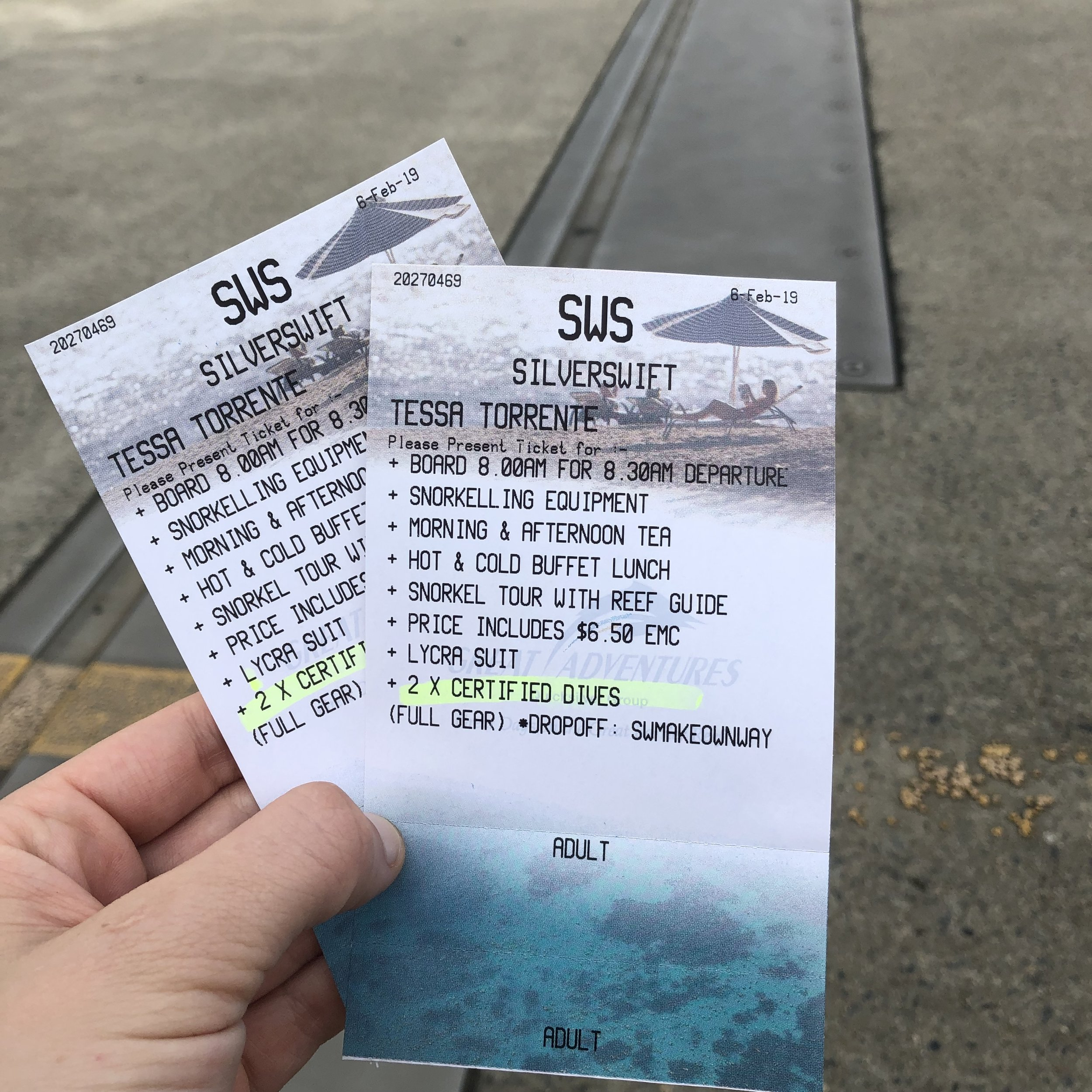 Vouchers exchanged for tickets, ready to board the boat for a day of diving.