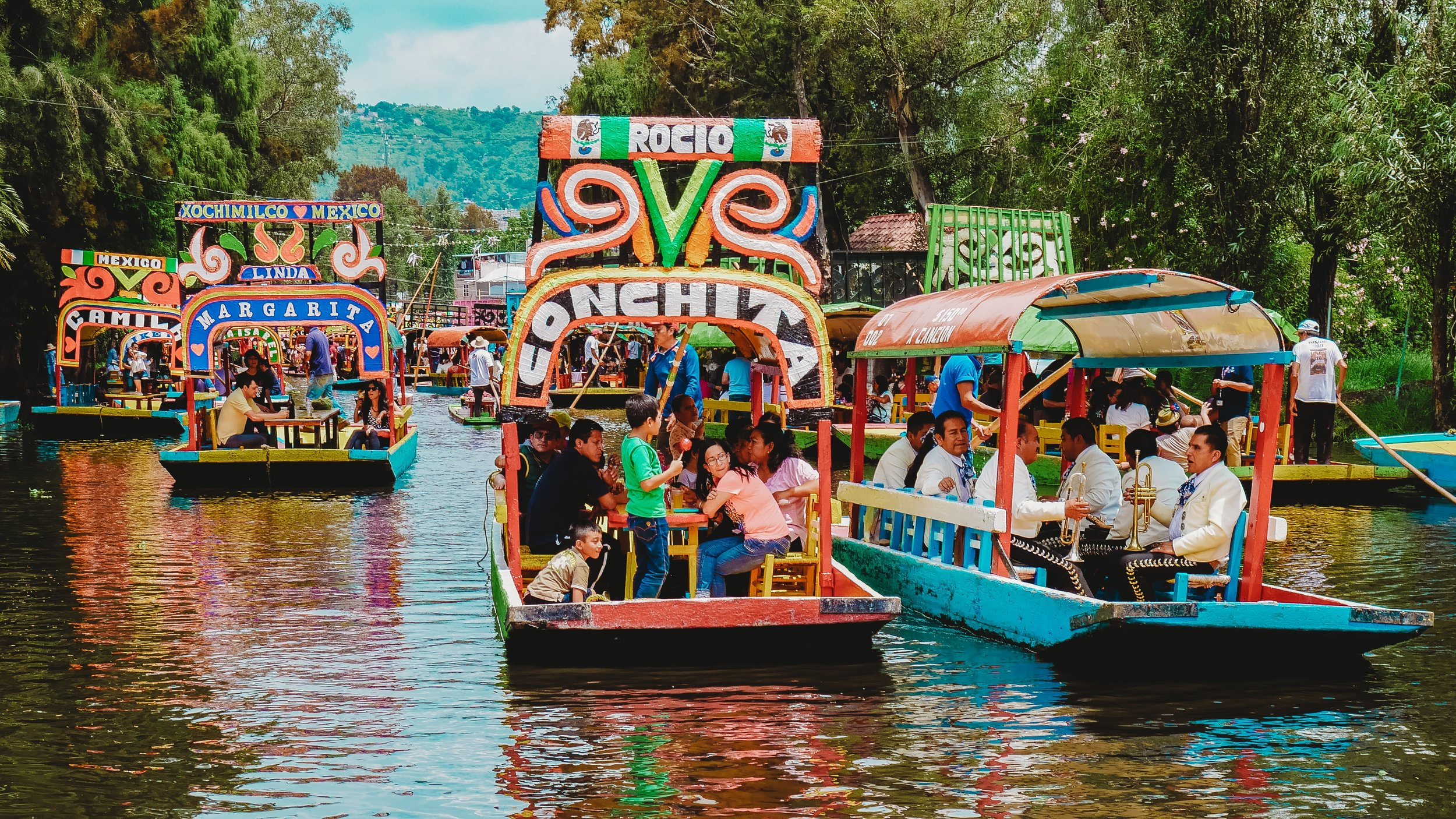 The boats - known as trajineras - will take you on a lazy float down the canals in the Xochimilco district of Mexico City