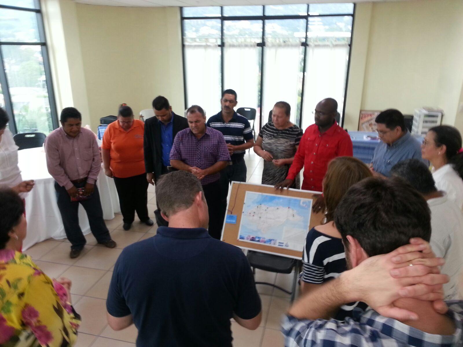 San Pedro Sula pastors prayer over map.JPG