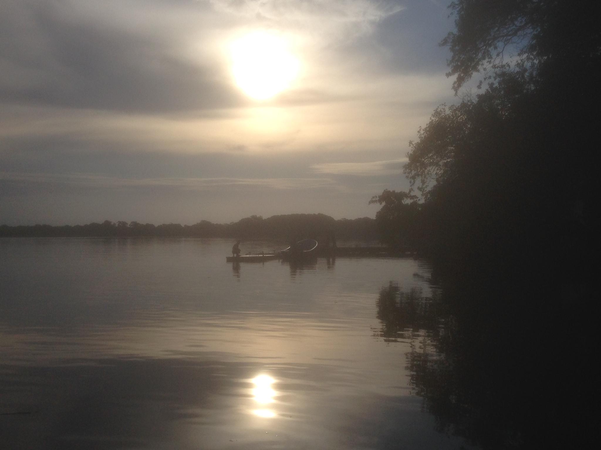 Waiting canoes sunset.JPG