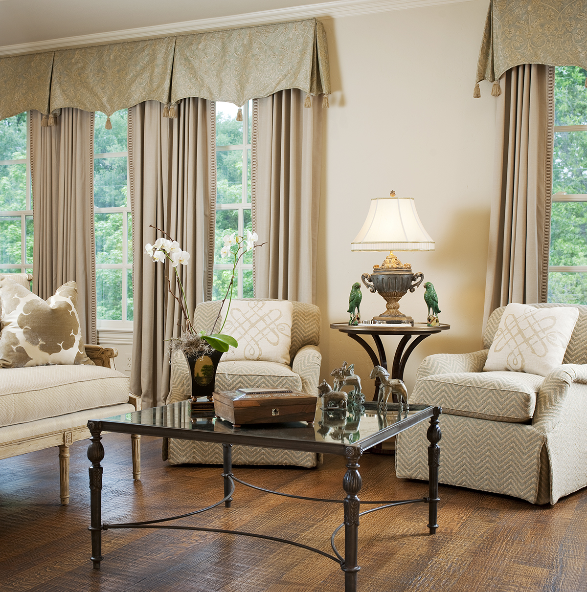 We incorporated antiques into this University Park bedroom while also using simple drapes, clean lines, and neutral tone-on-tone colors. The result is a room both classical and refreshingly modern.