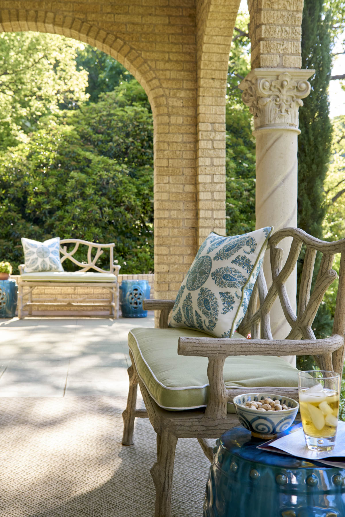 We decorated this outdoor patio with faux bois benches by Currey & Company.