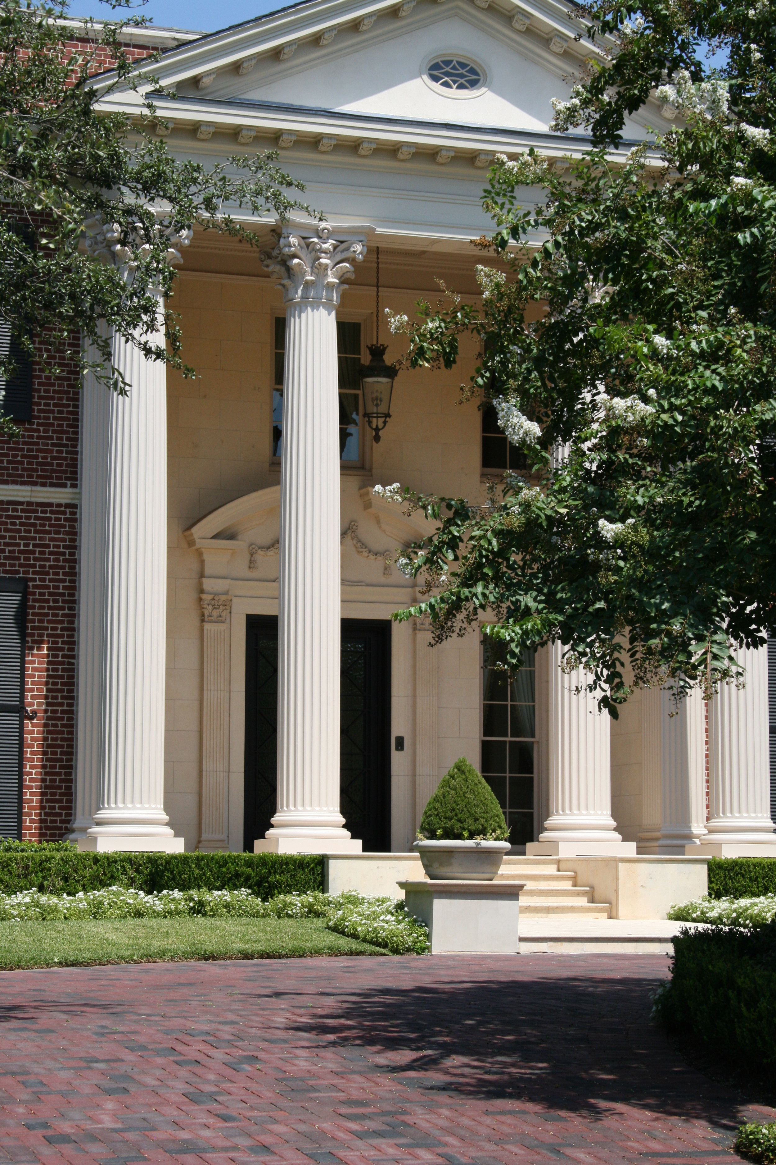 In this photo of a home designed by Paul Turney, you can see examples of both dentil moldings and Corinthian columns. Dentil moldings line the pediment over the front porch. (This image is copyright of  Turney & Associates, Inc.  Chambers Interiors & Associates was given permission to feature this image).