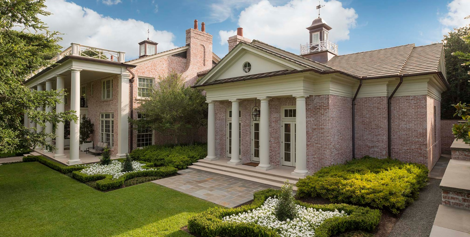 Like many famous Neoclassical buildings, this home by Ralph Duesing in Westover Hills has a large triangular pediment. (This photo is copyright of  Ralph Duesing Architect, LLC . Chambers Interiors & Associates was granted permission to feature this image).