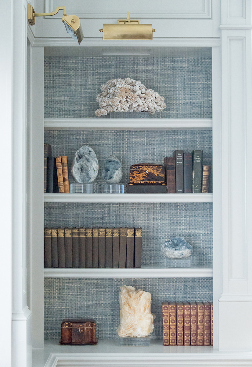 If you have built-in bookshelves, don't fill them entirely with books. Instead, leave a small selection of your most attractive books and accessories to showcase them. This photo is from the Theta house library we designed at SMU in Dallas.