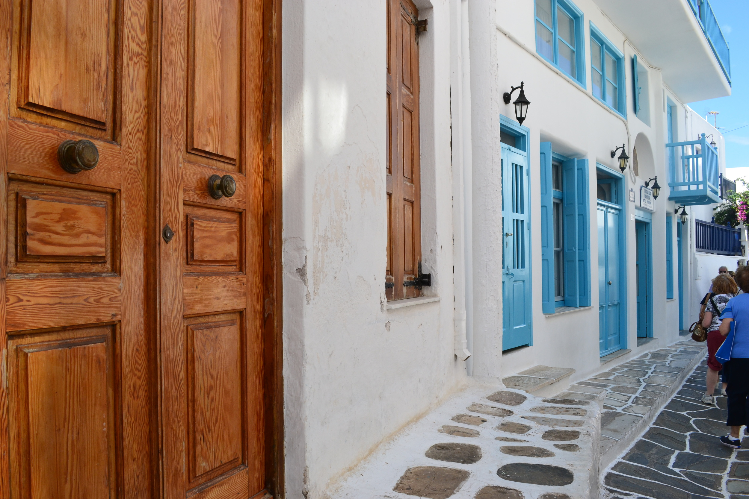 I was in love with Mykonos's white washed tiny streets and colorful doors.