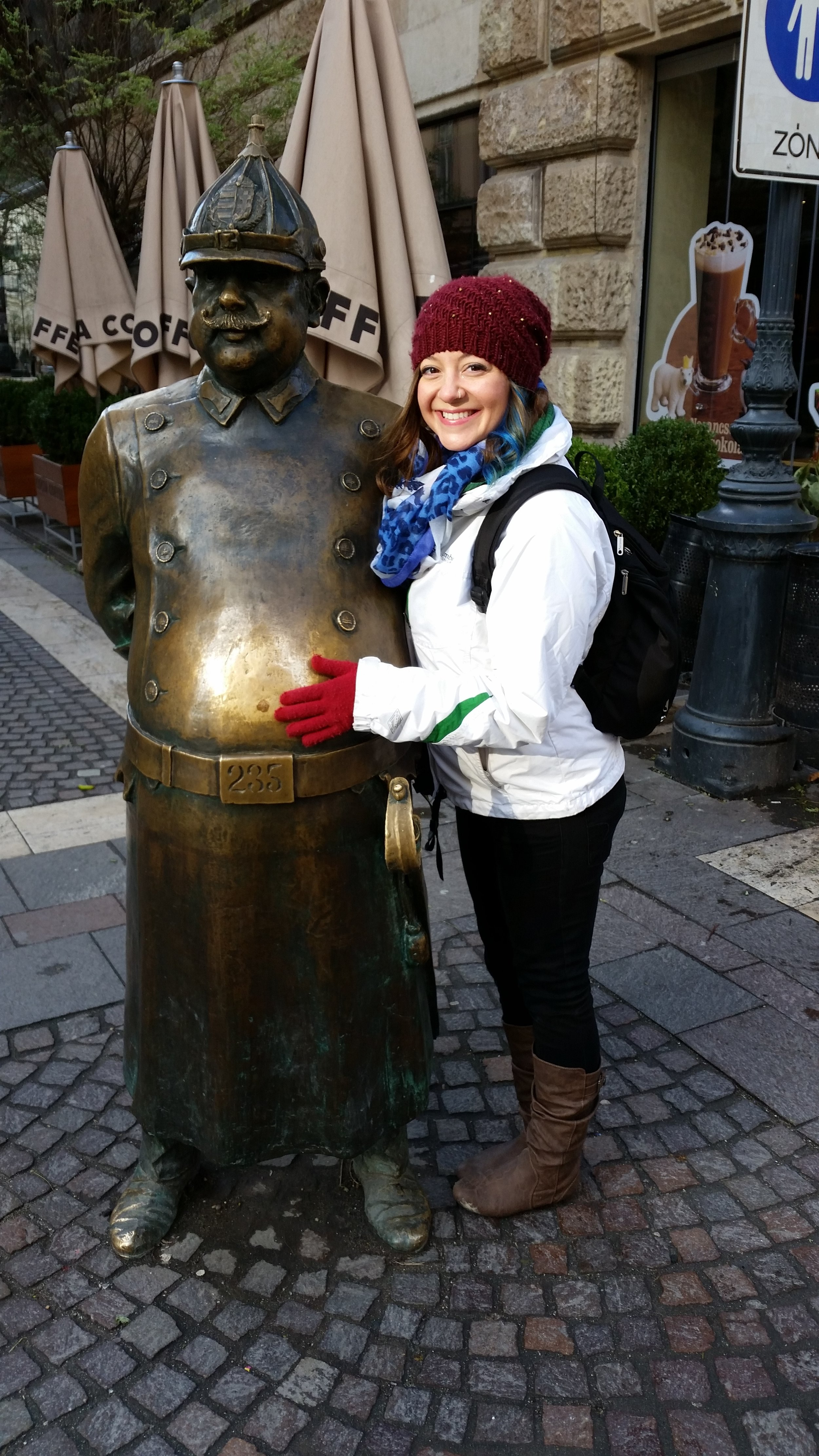 Rubbing the fat lucky tummy of the bronze policeman