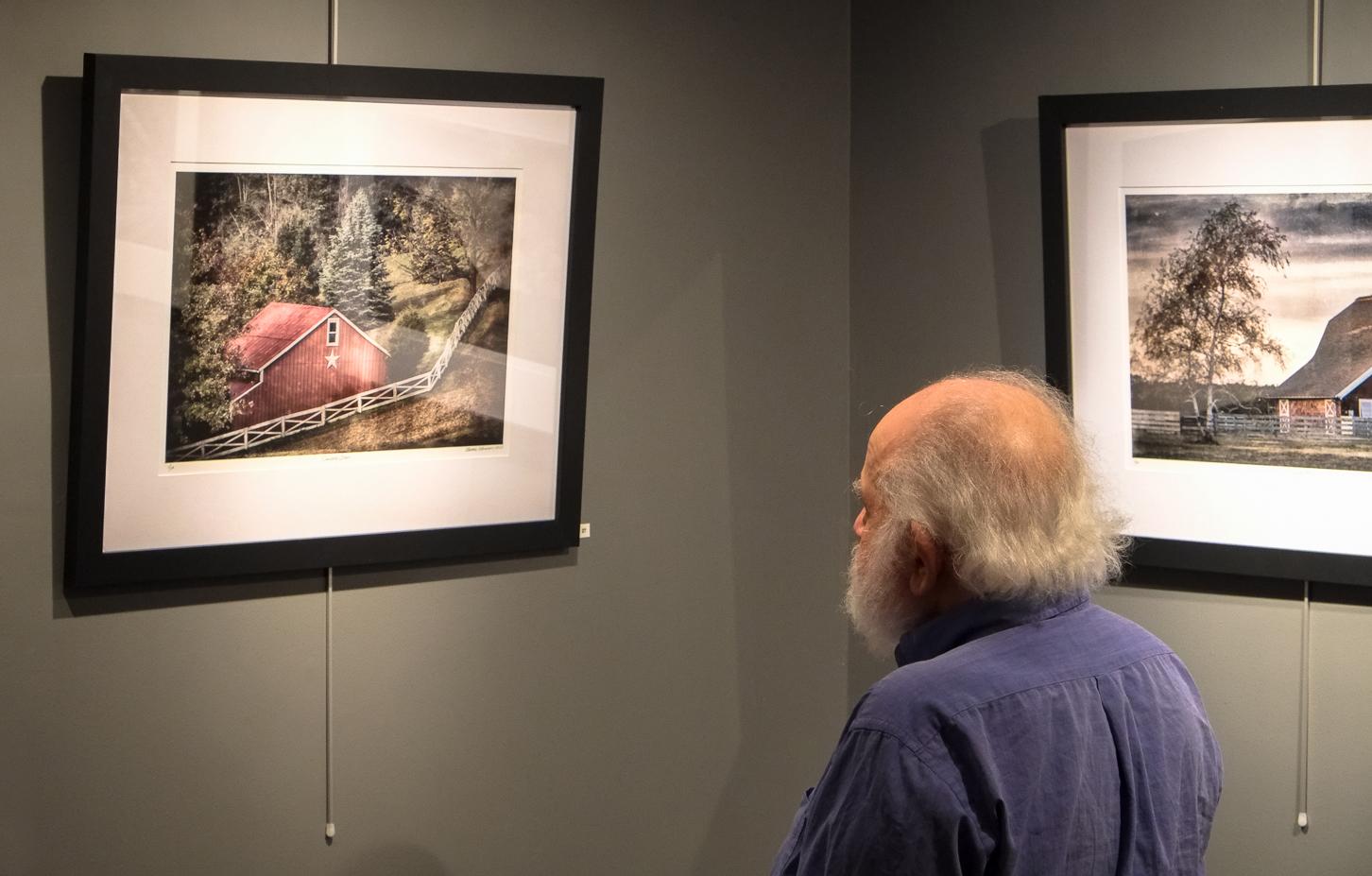 Michael Edelson admiring works.jpg