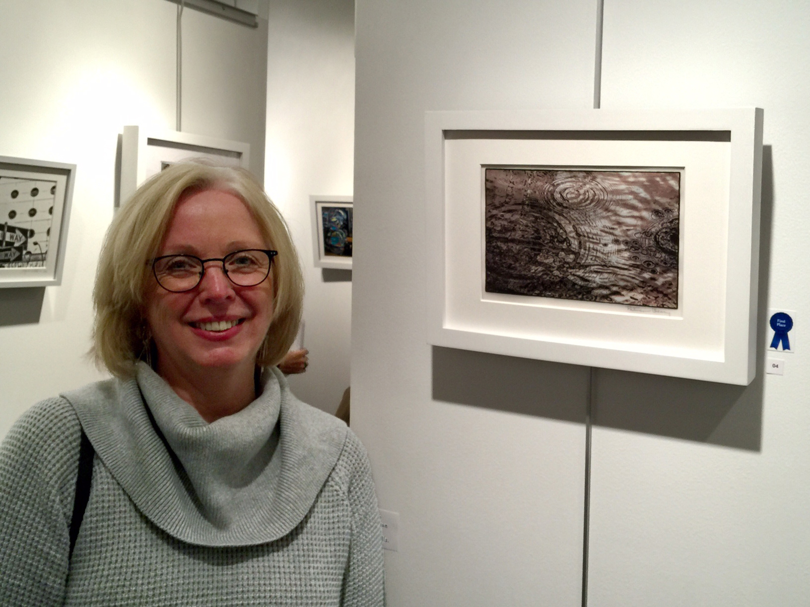 First Place Prize winner Patricia Beary with her work, Worlds Collide