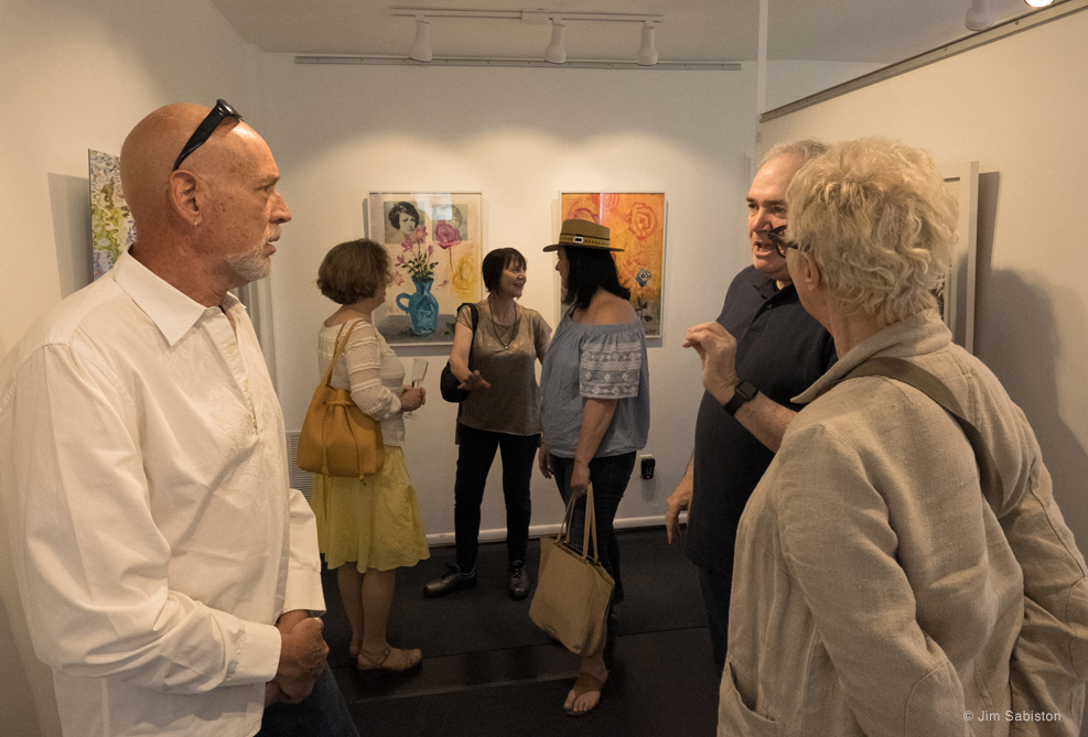 Artist, Steven Schreiber with guests. In background, artist, Katherine Liepe-Levinson with guests, Suzette Reiss and director East End Arts, Diane Burke.
