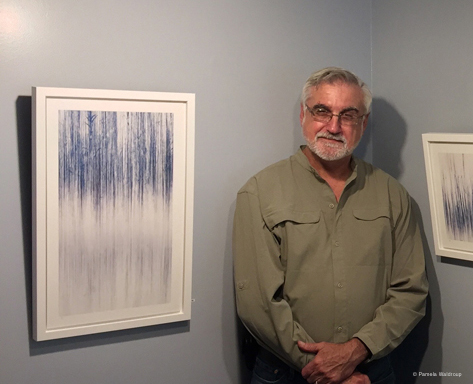 "Photographer, Jim Sabiston with his work,  ""Water Spirits VIII""."