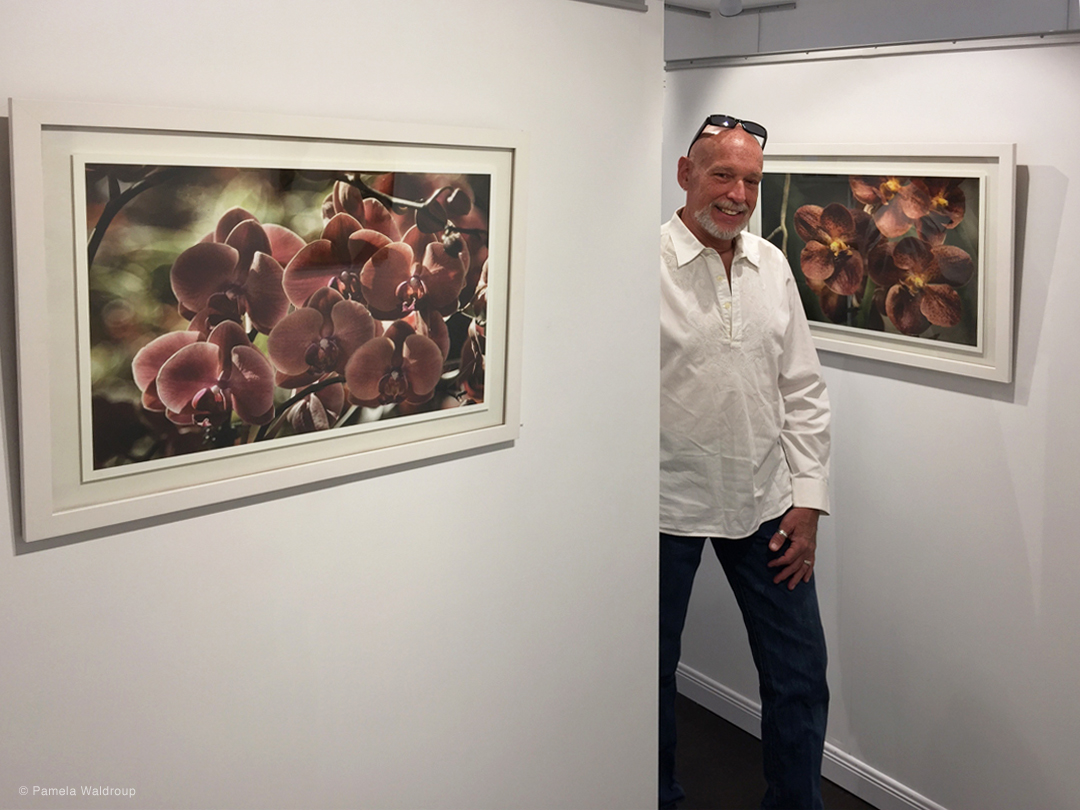 Photographer, Steven Schreiber with his beautiful orchids.
