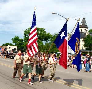 The Glen Rose parade, led by Boy Scout. Photo Credit: M'Lissa Howen.