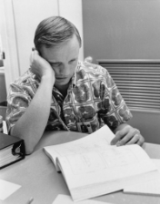 Neil Armstrong doing his homework before the mission. Photo Credit: NASA. Licensed via WikiMedia Commons (Public Domain).