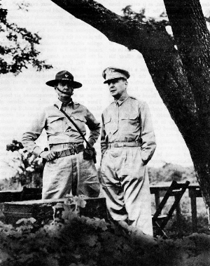"""MacArthur with Lieutenant General Jim """"Skinny"""" Wainwright during the defense of Bataan. Wainwright was left behind and taken captive by the Japanese. The Russians found him in an a POW camp as the war ended. MacArthur made sure the emaciated Wainwright stood directly behind him as MacArthur accepted the Japanese surrender on the U.S.S. Missouri. Photo from the Public domain via the Center of Military History, united States Army and  WikiMedia Commons"""